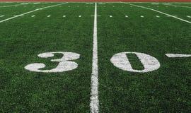 Yard-Line 30 auf amerikanischem Fußballplatz lizenzfreies stockbild
