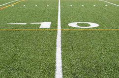 The 10 yard line. Image of artificial turf at football field with 10 yard line royalty free stock image