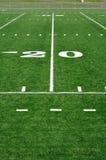 Yard-Line Zwanzig auf amerikanischem Fußballplatz Stockbilder