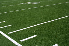 Yard lines on football field. A close up of the lines on a football field Royalty Free Stock Images
