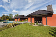Yard and luxury mansion. With swimming pool Stock Photography