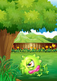 A yard with a monster resting under the tree Royalty Free Stock Photos