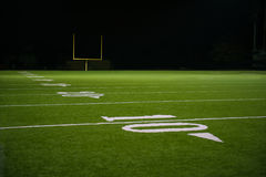 Yard Numbers and Line on American Football Field. 10, 20, & 30 Yard Line on American Football Field with Football Goal Post in distant stock image