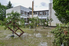The yard of the primary school destroyed swollen river Stock Image