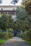 A yard of the Primate Cathedral of Saint Mary of Toledo. With a garden of orange trees, gates and a footpath, Castilla-La Mancha, Spain Royalty Free Stock Photo