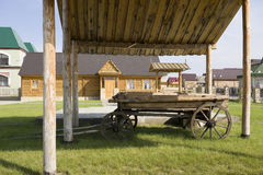 The yard of the rural house. Horse-drawn carriage under the canopy Stock Photos