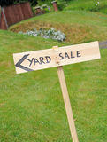 Yard Sale. A wooden hand painted yard sale sign outside stock photo