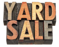 Yard sale banner in wood type. Yard sale banner  - isolated text in vintage letterpress wood type printing block stained by color inks Royalty Free Stock Image