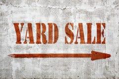 Yard sale graffiti on stucco wall. Yard sale - graffiti sign with an arrow on stucco wall stock photography