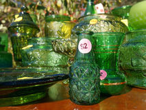 Yard Sale Green Glass Items Royalty Free Stock Photo