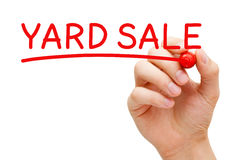 Yard Sale Hand Red Marker. Hand writing Yard Sale with red marker on transparent wipe board Royalty Free Stock Images