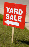 Yard sale sign. Red sign for yard sale on lawn Stock Photography