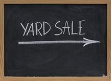 Yard sale sign on blackboard. Yard sale text handwritten with white chalk on blackboard Royalty Free Stock Images
