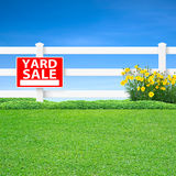 Yard sale sign and fence. Yard sale sign and long white fence with green grass Stock Images