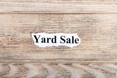 yard sale text on paper. Word yard sale on torn paper. Concept Image Stock Photo