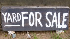 Yard for sale text. On the wooden sign Stock Image