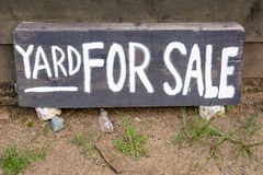 Yard for sale text. On the wooden sign Stock Photography