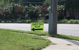 Yard Sale Today Sign. A yard sale sign advertises to people traveling by in their cars that there is a yard sale today Royalty Free Stock Images
