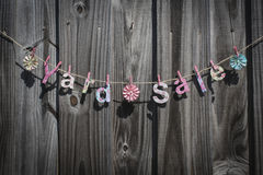 Yard Sale. The words 'Yard Sale' hanging on a string against a fence royalty free stock photography