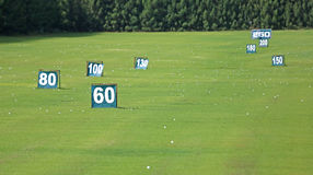 Yard signs in driving range Stock Image