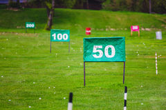 Yard signs in driving range Stock Images