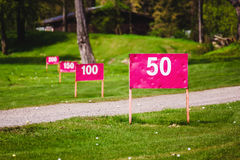 Yard signs in driving range Royalty Free Stock Photo