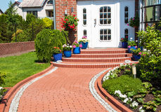 Yard of suburban home. Close-up of the main entrance of a typical suburban home royalty free stock image