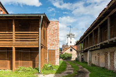 Yard with wood sheds. In the distance can be seen the church tow. City life. Yard with wood sheds Stock Photos