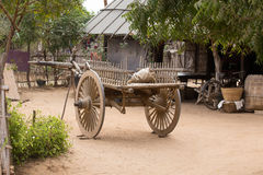 Yard with a wooden cart. Bagan, Myanmar Stock Photography