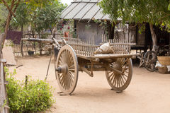Yard with a wooden cart. Bagan, Myanmar Stock Image