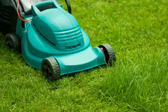 Yard work. Typical spring activity - mowing the lawn Stock Image