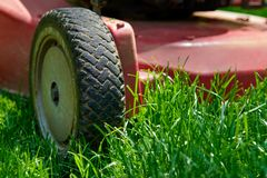 Lawnmower, cutting fresh green gras Stock Images