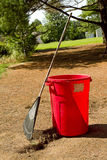 Yard Work Preparation. Rake leaning on red barrel in preparation of yard work Stock Photography