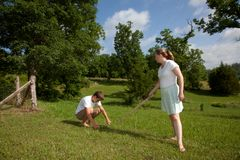 Yard Work. A teenage boy and women doing yard work Royalty Free Stock Photo
