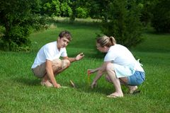 Yard Work. A teenage boy and women doing yard work Royalty Free Stock Image