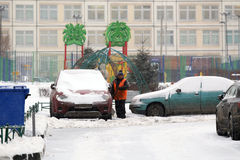 Yard worker is cleaning street from the snow Royalty Free Stock Image