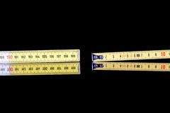 Yardstick and meter roll Stock Photography
