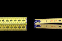 Yardstick and meter roll Stock Images