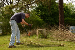 Yardwork bundling twigs Royalty Free Stock Photo