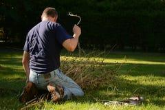 Yardwork bundling twigs Stock Photos