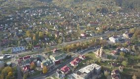 Yaremche - Ukraine, OCTOBER 14, 2017: Aerial view to autumn carpathian city Yaremche at sunny day. Aerial view to autumn carpathian city Yaremche at sunny day stock footage