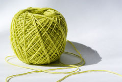 Yarn. Knot of green yarn against light background stock images