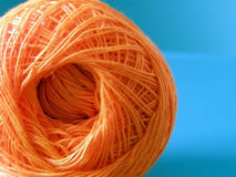 Yarn. Ball of orange yarn used for sewing Stock Photos