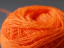 Yarn. Ball of orange yarn used for sewing Royalty Free Stock Image