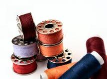 Yarn. On bobbin coil in multicolors royalty free stock photos