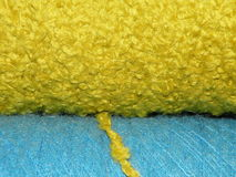 Bright Yellow and Blue Spools of Yarn Stock Photo