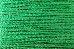 Yarn-Background. Background, made of a spool of green yarn royalty free illustration