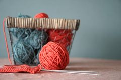 Yarn balls and basket. Color thread for knitting. Colors concept royalty free stock images
