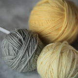 Yarn balls and needles Royalty Free Stock Images