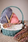 Yarn balls and round needles set in a basket Stock Photos